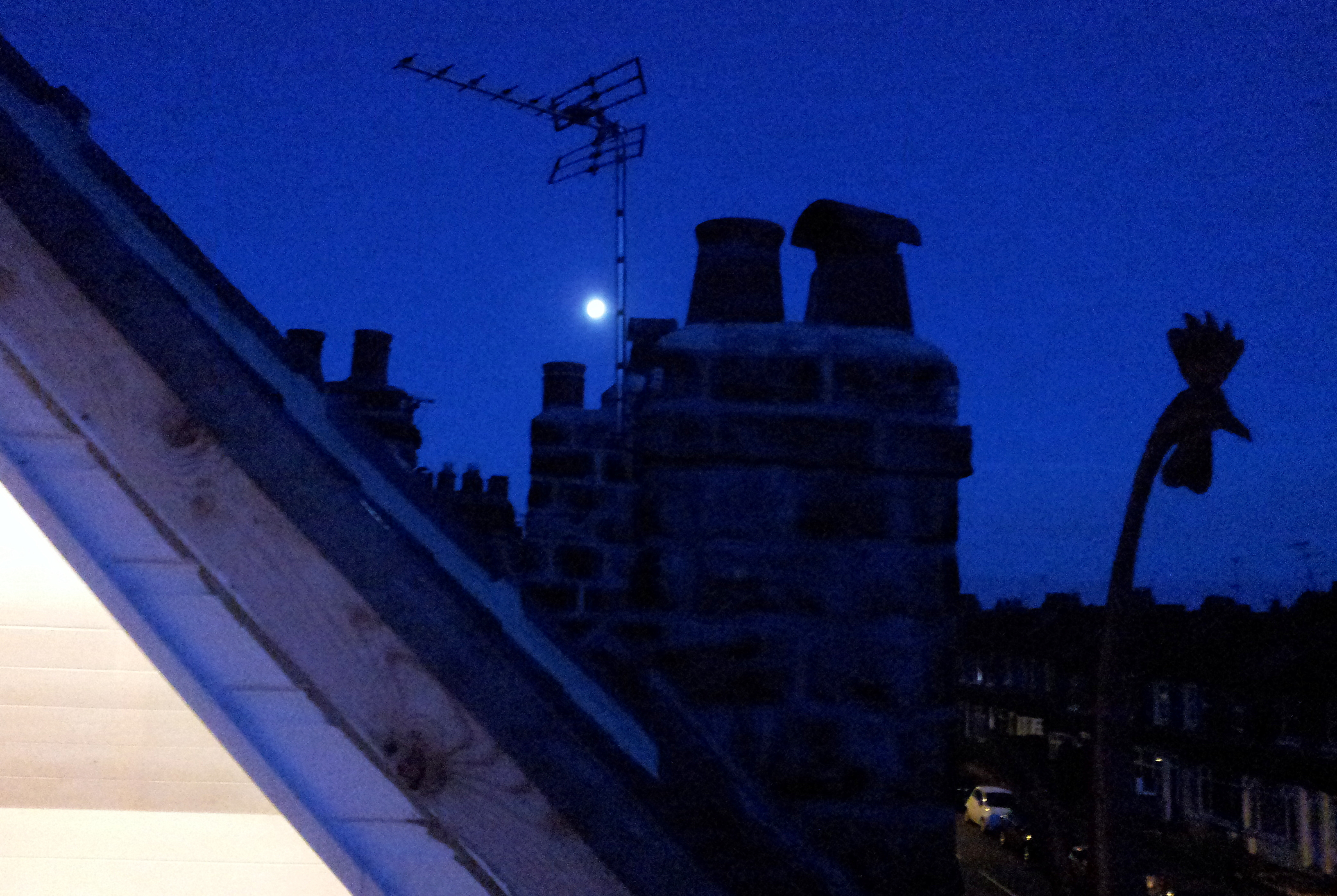 The moon from a roof terrace, Harrogate Yorkshire.