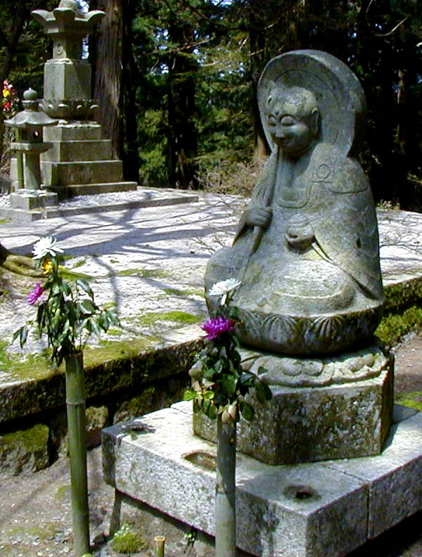 Jizo with staff, jewel and hat?