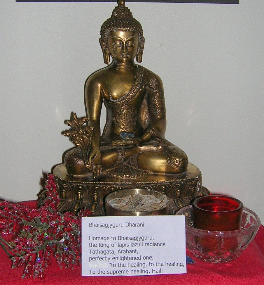 Bhaisajyaguru with healing herbs in the right hand.